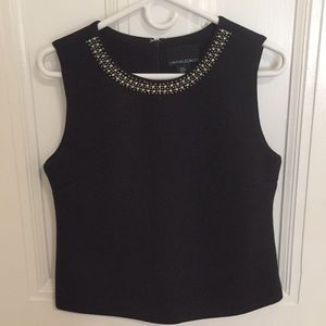 Structured black top with embellished collar